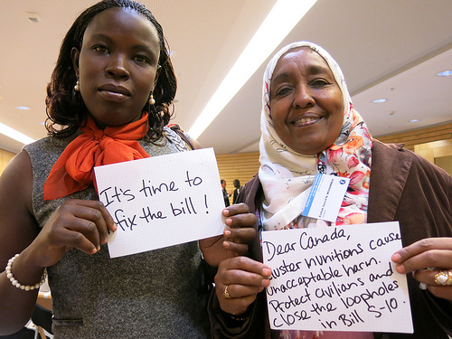 CMC Campaigners Mystical Lagua from the Uganda Landmine Survivors Association and Aisha Saeed from the Yemen Mine Awareness Association (from left to right) call on Canada to fix the bill.